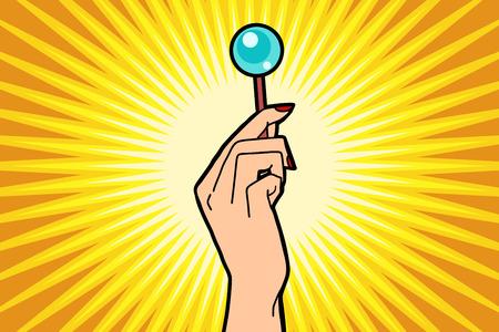 Lollipop in female hand. Comic book cartoon pop art retro color illustration drawing