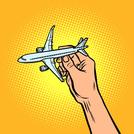 passenger plane in hand. metaphor of travel and tourism. Comic cartoon pop art vector retro vintage drawing