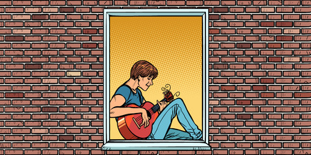 Young man playing acoustic guitar, sitting in the window