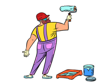 A male house painter paints a wall