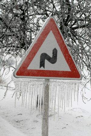 Traffic sign covered with ice and icicles Stock Photo