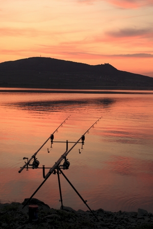 Reservoir of Nove Mlyny at sunset with fishing rods in the foreground  Southern Moravia, Czech Republic