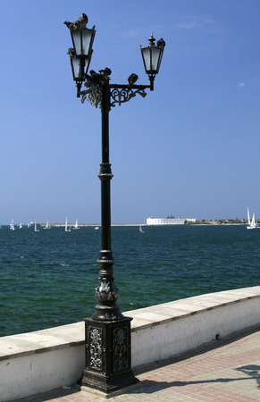 Old metal street lamp on the waterfront of Sevastopol Stock Photo
