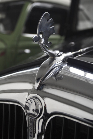Detail of the bonnet of classic car Skoda with the old emblem of the company Editorial
