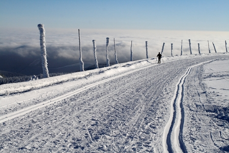 inversion: Modified cross-country ski trail on the top of Praded - the highest peak of Jeseniky mountains, Czech Republic. Inversion under the hills. Stock Photo
