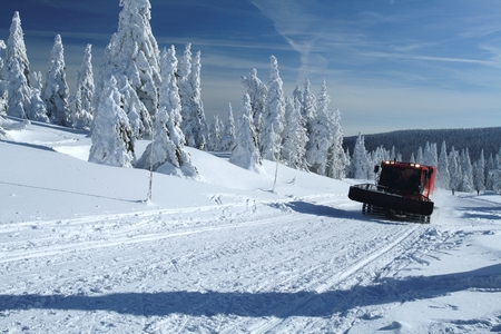 snow grooming machine: Winter landscape with a snow cat preparing cross-country skiing trails in the Jeseniky mountains, Czech republic. Stock Photo