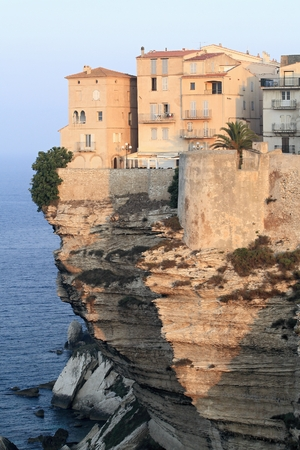 Sunrise at the limestone cliffs and buildings in Bonifacio, Corsica photo
