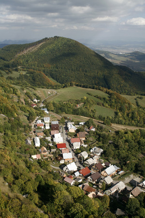 Village in the White Carpathians. The picturesque village vr?atsk? podhradie on the border of Slovakia and the Czech Republic, known for ITS ruins of the castle towering above the village.