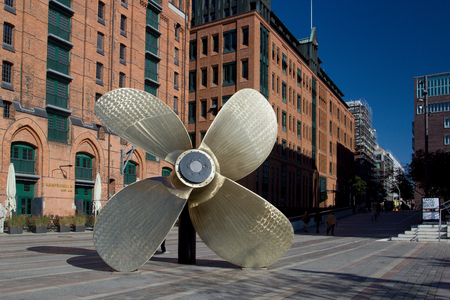 Giant four-blade ship propeller in front of the International Maritime Museum in Hamburgs Speicherstadt district, Germany. Editorial