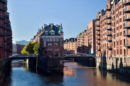 The famous Wasserschloss (Watter Castle) in the historic Speicherstadt - the largest warehouse district in the world, located in the HafenCity quarter in Hamburg, Germany. Stock Photo