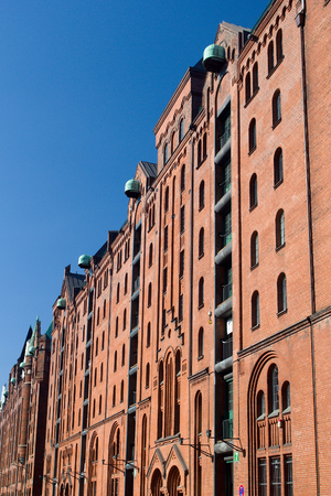 Red brick facade of warehouse buildings in Speicherstadt - the largest historic warehouse in the world, located in the HafenCity quarter, Hamburg, Germany.