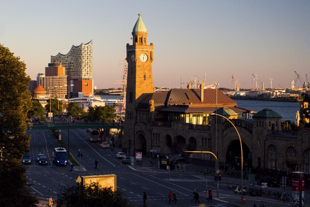 Evening view of the famous Hamburger Landungsbruecken with the commercial harbor, the Elbe river and the new building of the Hamburg Philharmonic.