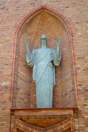 Blessing Christ statue on the building of the church of St. Mary of the Scapular in Druskininkai, Lithuania