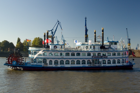 Touristic paddle-steamer Louisiana Star on the river Elbe in the port of Hamburg.