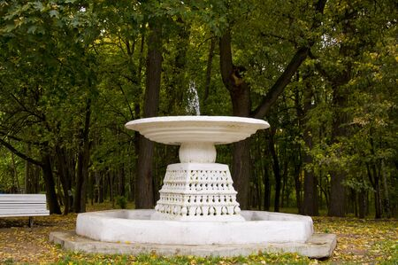 The fountain in the autumn park Stock Photo