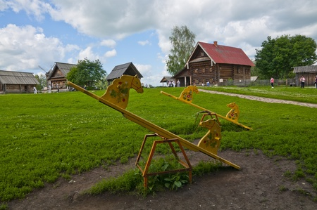 Rural landscape with a house and children s swings photo