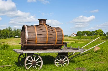 Cart with a keg in the rural landscape