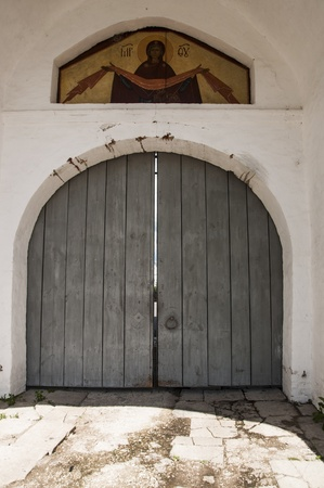 Old monastery gate photo
