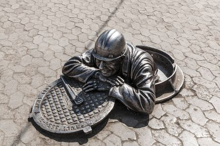 Sculpture plumber character Omsk