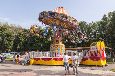 Park with carousels and attractions