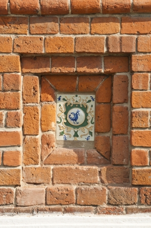 Tiles on the brick wall photo