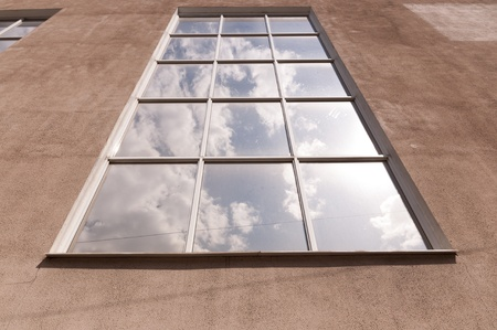 The window in which is reflected the sky with clouds Stock Photo - 16980361
