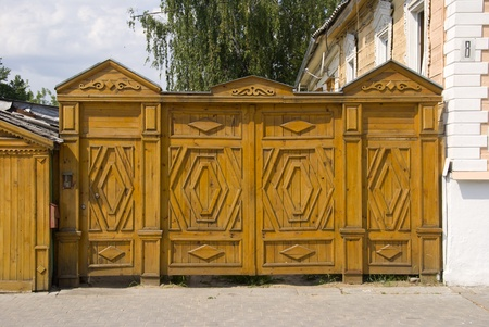 Carved wooden gate in the Russian style