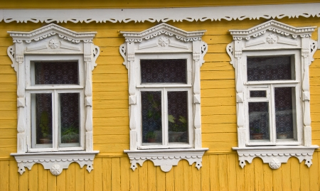 Carved wooden facade in traditional Russian style photo