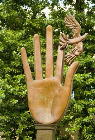 letting: Sculpture of hands letting the bird