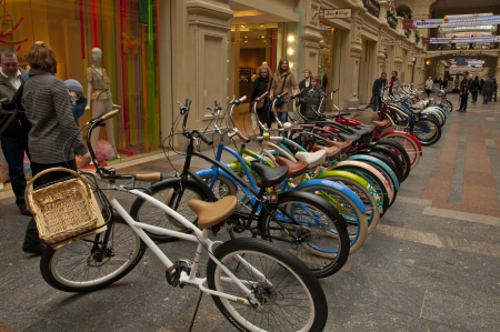 world at your fingertips: Bikes in a shop window Editorial