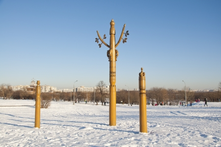 Wooden totem poles on the snow field photo