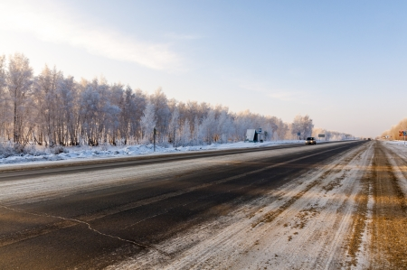 The road that goes through the snowy Russian province Stock Photo