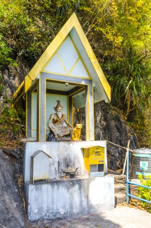 Buddhist chapel in a monastery on the mountain cave tiger photo