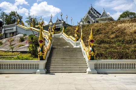 Thai Buddhist temple decorated with white ornaments with dragons and lanterns photo