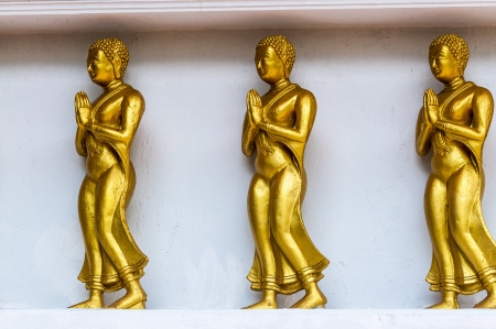 Thailand monastery of Wat Bang Riang, province of Phang Nga  The statues of Buddhist deities with the interior wall of the temple
