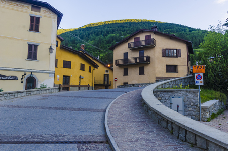 Streets and houses in the mountain town of Alpine Italian Ponte di Legno region Lombaridya Brescia, northern Italy in the early morning  Stock Photo - 22826202
