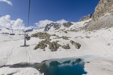 chair on the lift: Chair lift for skiers on the top of the Alps