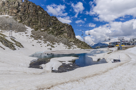 Melting snow on the top of the Alpine mountains in the summer. Northern Italy Stock Photo