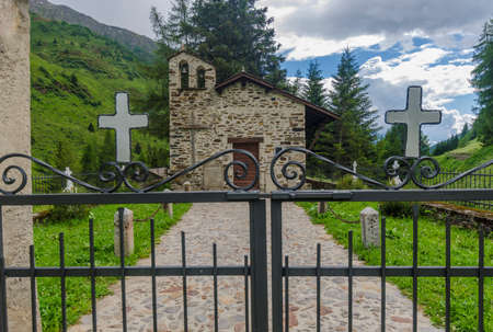 A small church in the village cemetery in the northern Italian Alps Stock Photo