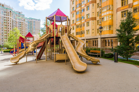 learning new skills: Childrens playground in the courtyard of an apartment house in the summer Stock Photo