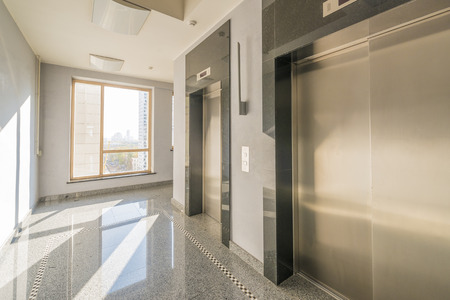 entrance of a residential building with an elevator Stock Photo
