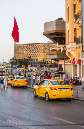 Yellow taxi on the Square in the European part of Istanbul Editorial