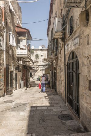 arcos de piedra: narrow streets of old Jerusalem. Stone houses and arches
