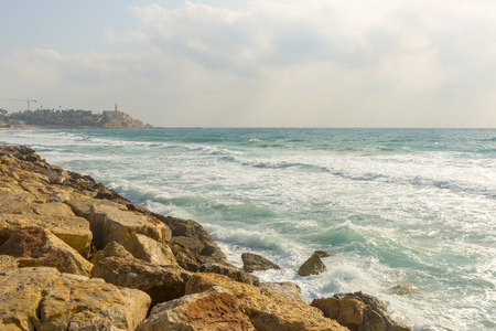 Waves of the Mediterranean sea beating against the stony shore Stock Photo