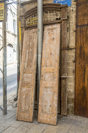 jewish houses: The streets of Tel Aviv. Old door and a fragment of the facade in Jaffa Stock Photo