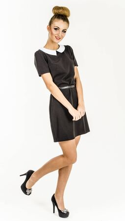 Young girl in a student dress with white collar Stock Photo