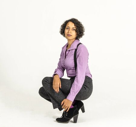 Beautiful mulatto woman in an office shirt and trousers