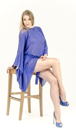 Beautiful slim blonde girl in a blue transparent shirt