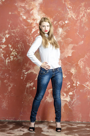 Beautiful girl in unbuttoned white shirt and jeans Stock Photo