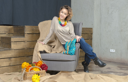 young girl: Young girl in sofaand fashionable bag